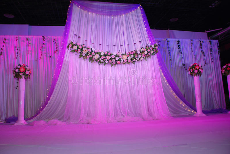 Wedding Stage. Stage theater curtains with flowers at wedding reception stock photos