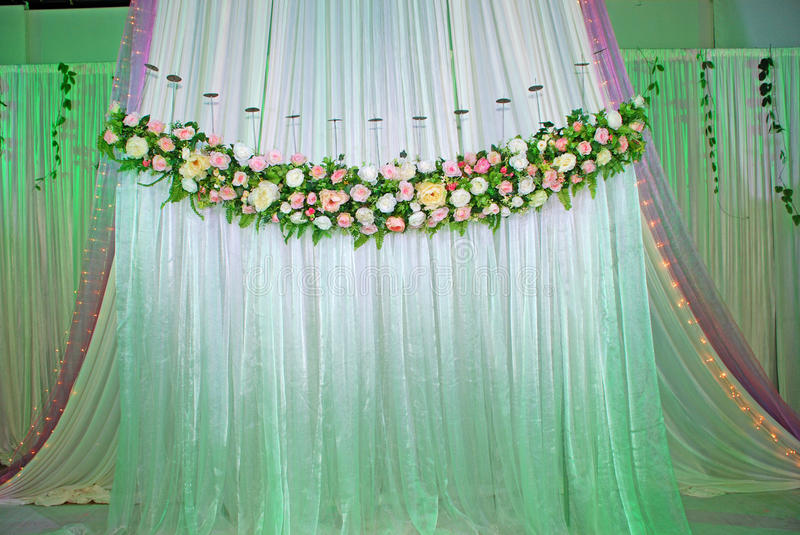 Wedding Stage. Stage theater curtains with flowers at wedding reception stock images