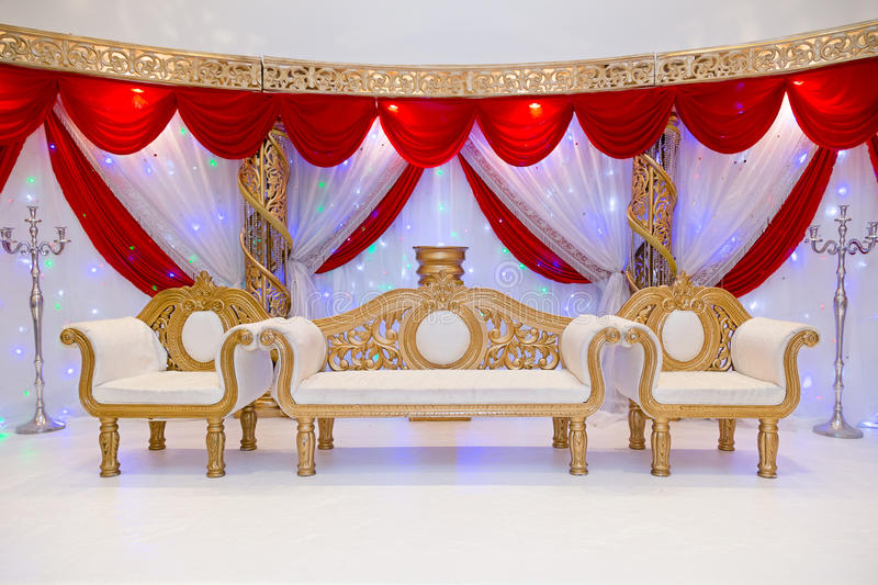 Wedding stage. Colourful red themed wedding stage stock photo
