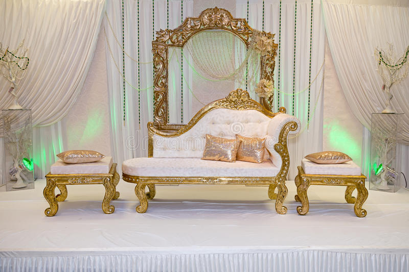 Wedding stage. Gold themed wedding stage with benches royalty free stock photography