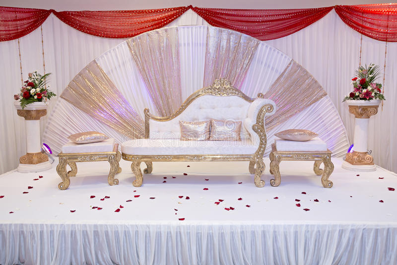 Wedding stage. Red themed wedding stage with gold trimmed benches royalty free stock images