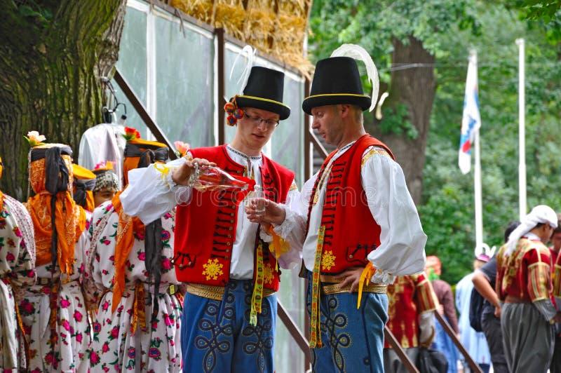 Wedding of Straznice, two men drinking stock image