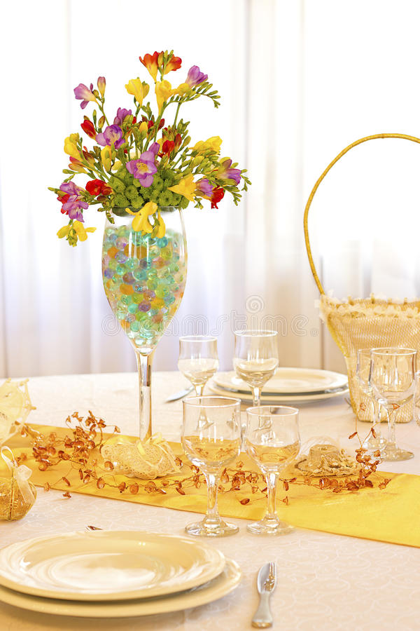 Wedding table. Colorful wedding arrangement with flowers and basket stock photos