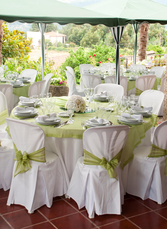 Wedding table. Gorgeous wedding chair and table setting for fine dining at outdoors royalty free stock images