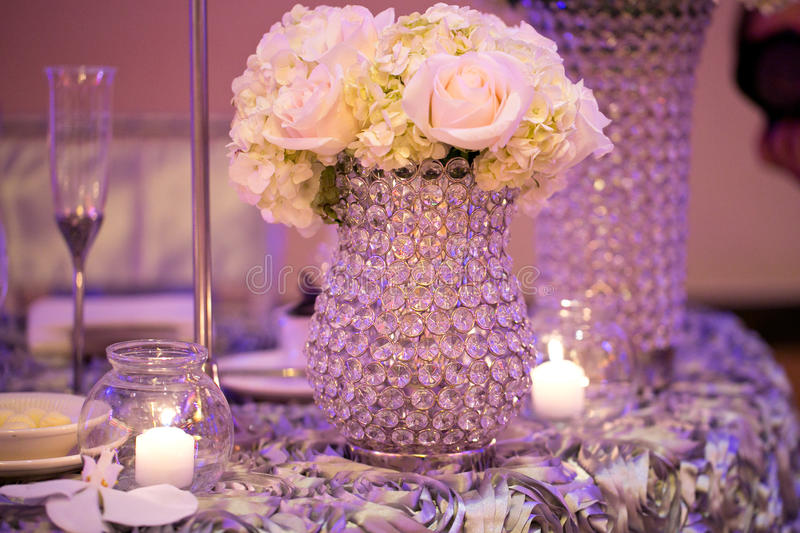 Wedding Table. Decorated wedding table with silverware dishes and flower center piece stock images
