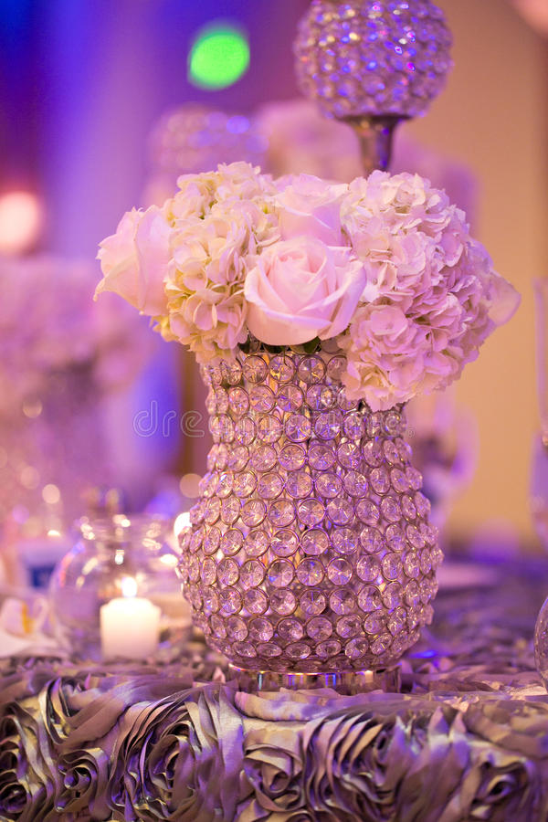 Wedding Table. Decorated wedding table with silverware dishes and flower center piece royalty free stock image