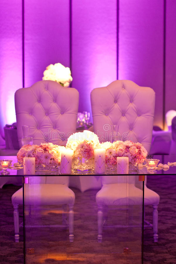 Wedding Table. Decorated wedding table with silverware dishes and flower center piece stock photo