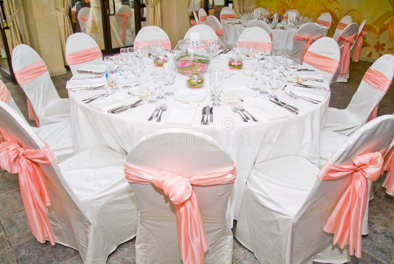 Wedding table. White white napkin and somon ribbons royalty free stock images