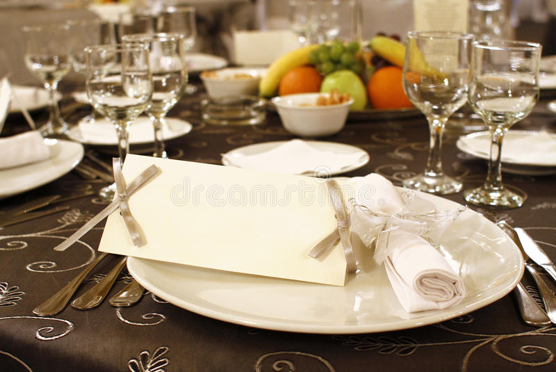 Wedding table arrangement with blank invitation stock images