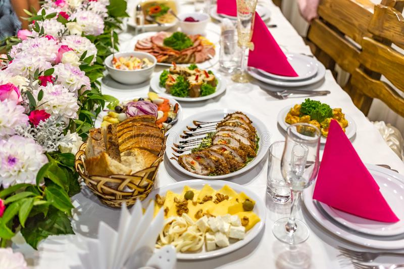 Wedding table for brides and their guests. Table with cheese, with cured meat, with other appetizers stock photography