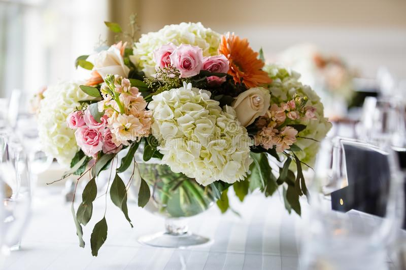 Table centerpieces with flowers stock images