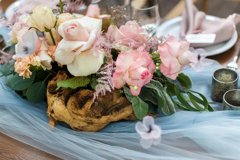Wedding table decoration with grey and blue tulle stock image
