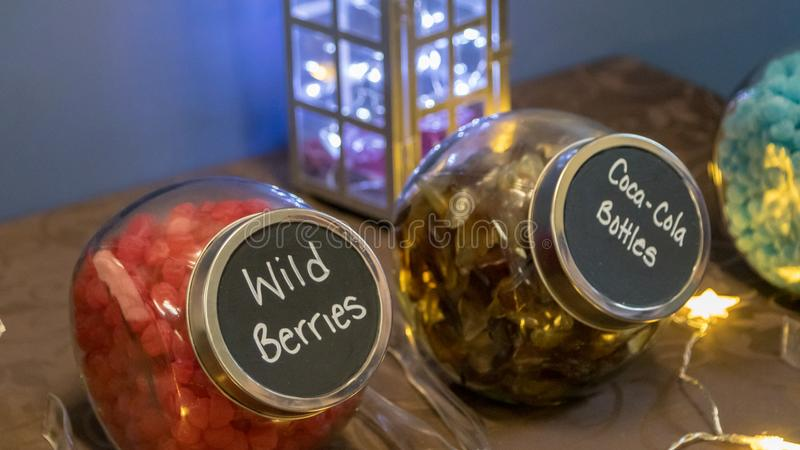 Wedding Table Decoration Lantern With Lights Behind Candy Jars stock photography