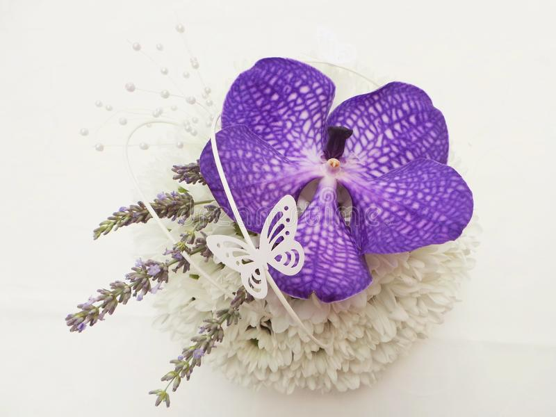 Wedding table decoration with purple flower orchid and butterfly stock image