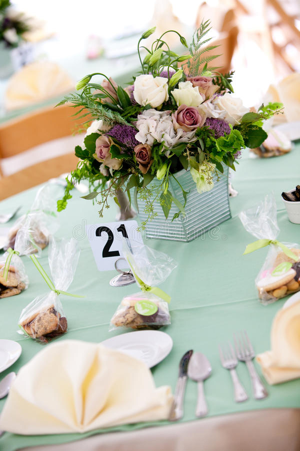 Wedding table with flower centerpiece stock images