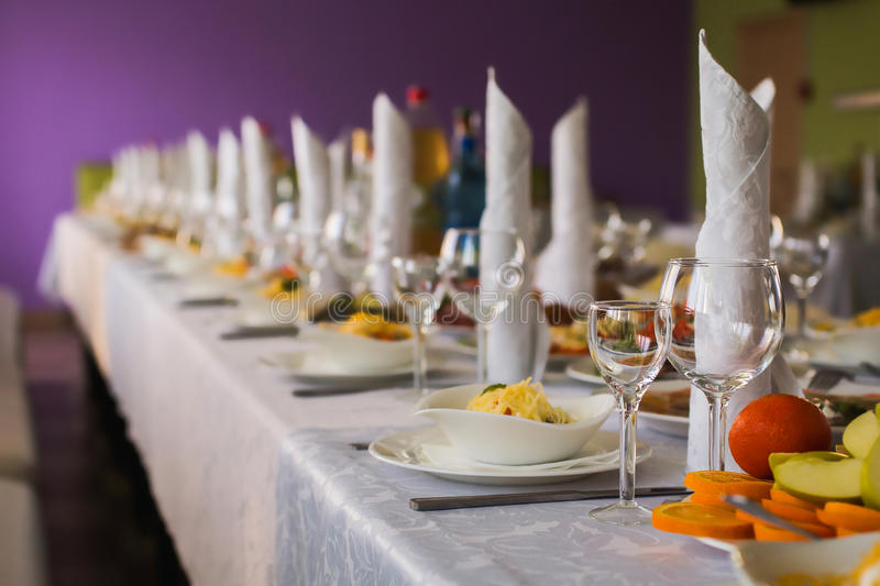 Wedding table with food. Empty glasses, wedding ceremony royalty free stock images