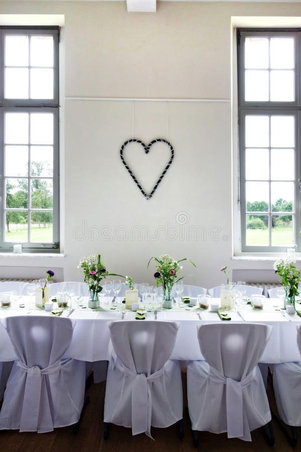Wedding table. Gorgeous wedding chair and table setting for fine dining royalty free stock image