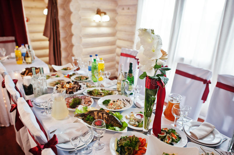 Wedding table for guests with decor flowers and food. stock photo