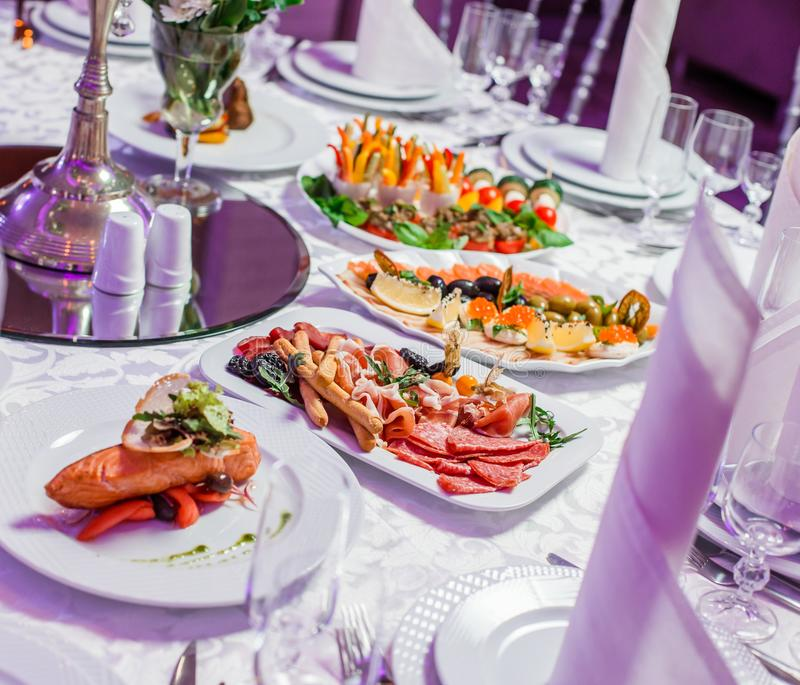 Wedding table served with tasty meals, antipasto platter cold meat, fish platter, cheese platter. Holiday banquet menu. Appetizer, catering food concept stock photos