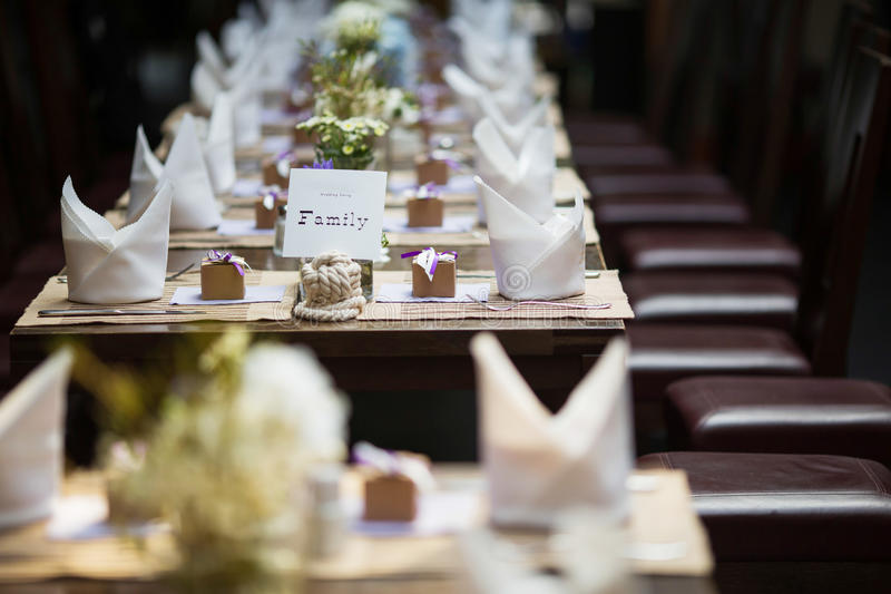 Wedding table. Set for dining,a family sign on the table royalty free stock photos