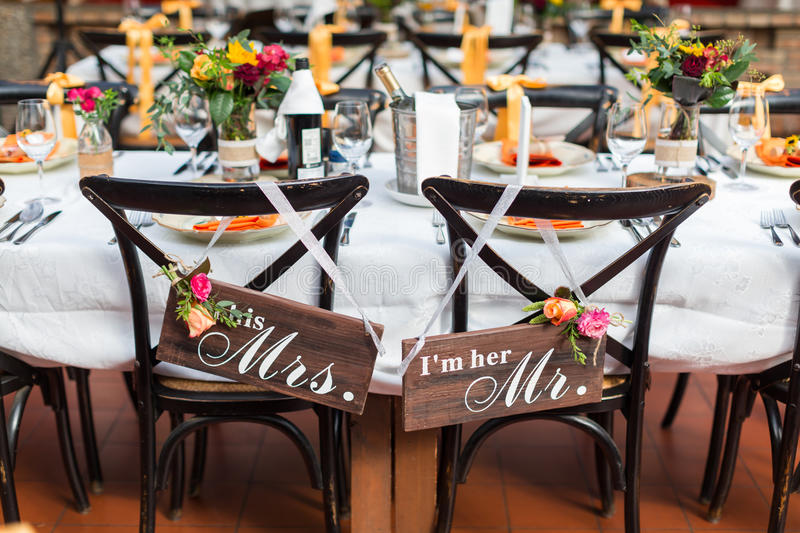 Wedding table. Set for dining in wedding party,Two signs hanging on the chair royalty free stock images