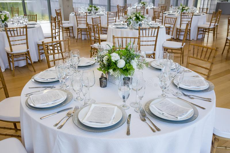 Wedding tables are set for fine dining at a fancy catered event - wedding table series stock photo
