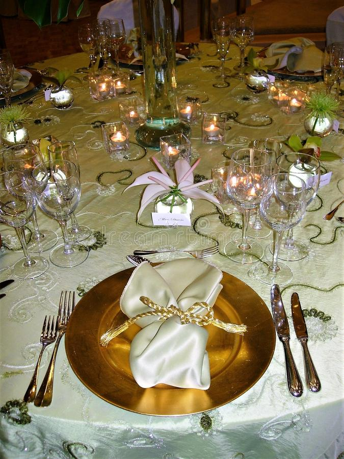 Wedding table setting with gold accents royalty free stock images