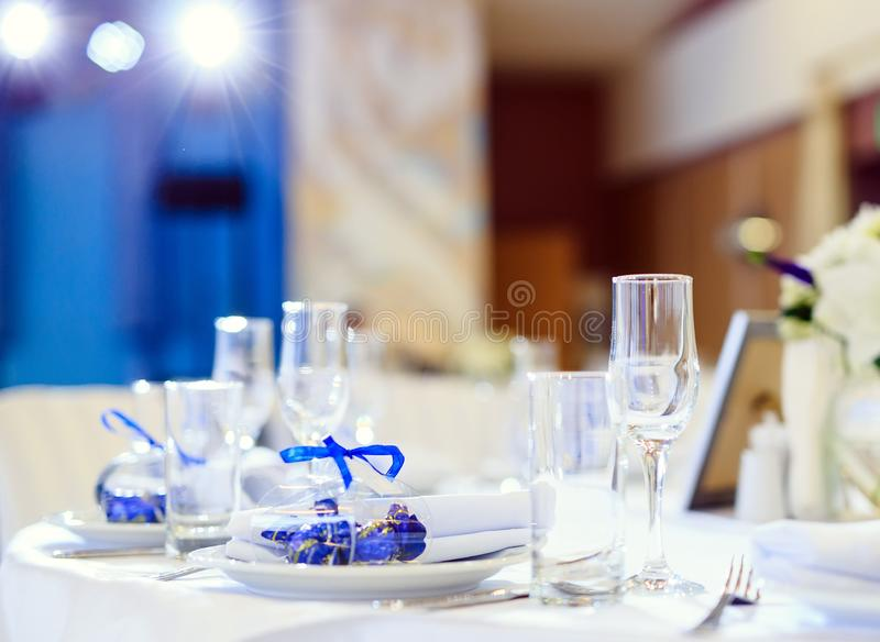 Wedding table setting in the restaurant on the white and blue background. stock photography