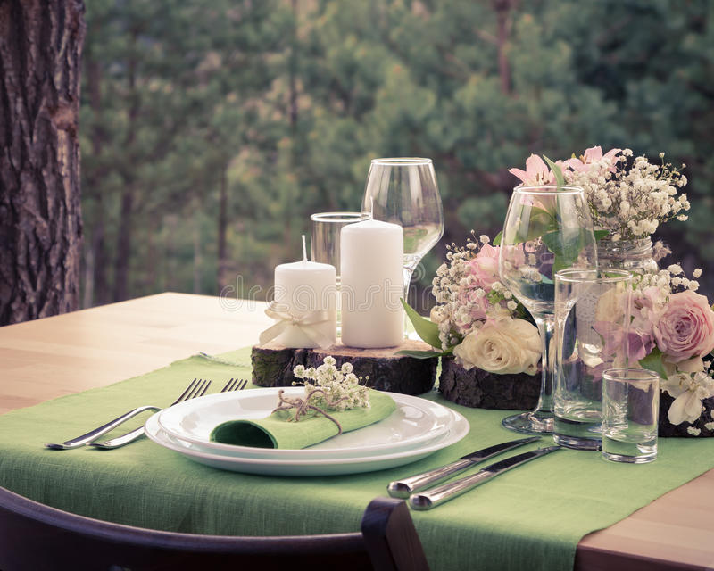 Wedding table setting in rustic style. Vintage stylized photo stock photography