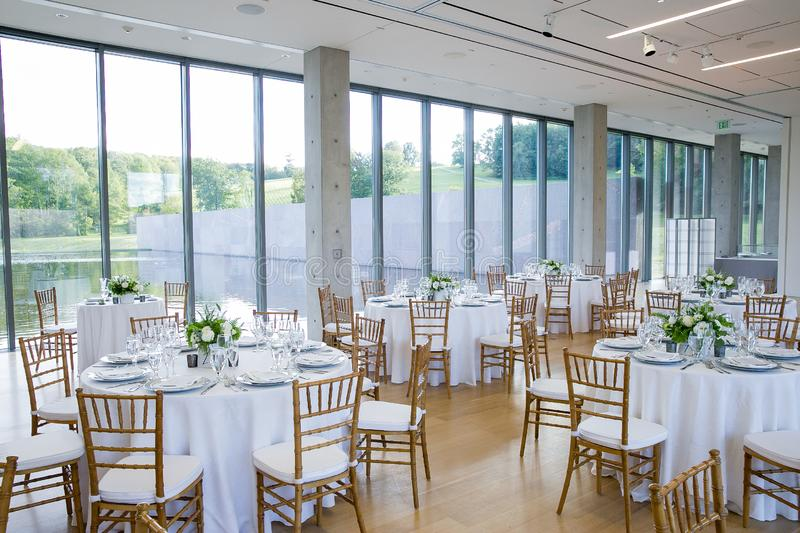 Wedding tables set for fine dining at a fancy catered event - wedding table series stock image