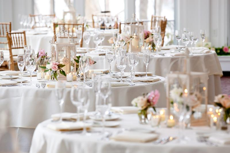 Wedding table decoration series - tables set for fine dining royalty free stock photos
