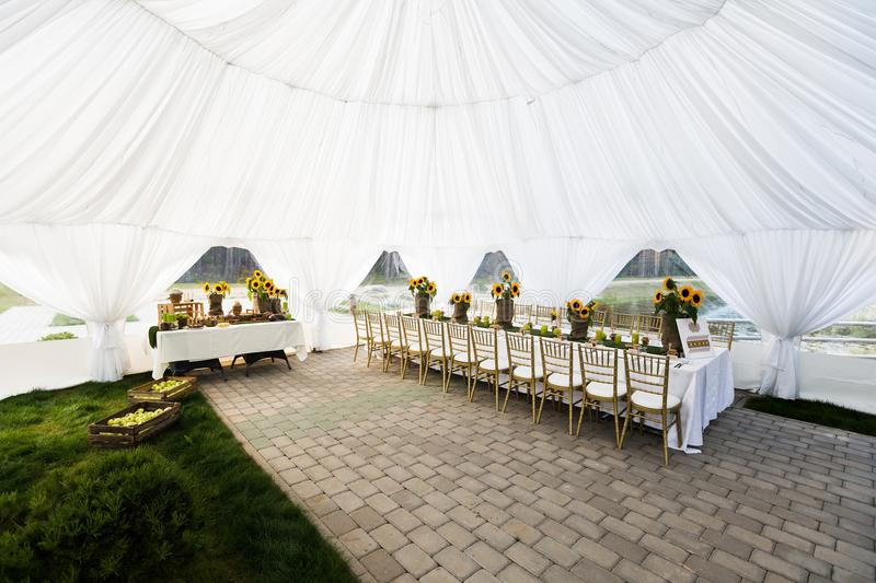 White Chairs At A Wedding Indoor Stock Photo: Wedding Tent Inside Stock Image. Image Of White, Grass