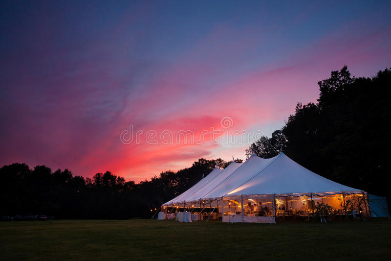 Wedding tent at night. An event tent in a field at sunset during a wedding stock photos