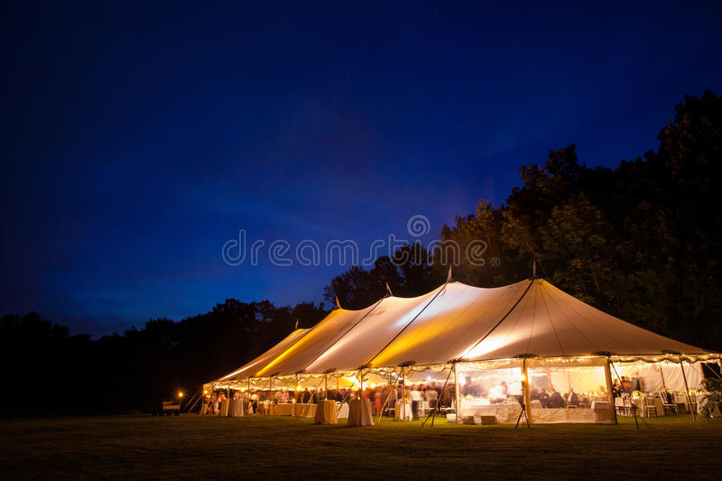 Wedding Tent at night. An event tent at night during a wedding. glowing from the lights inside royalty free stock image