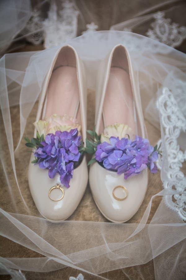 Wedding theme, elegant stylish wedding Shoes and rings stock photos