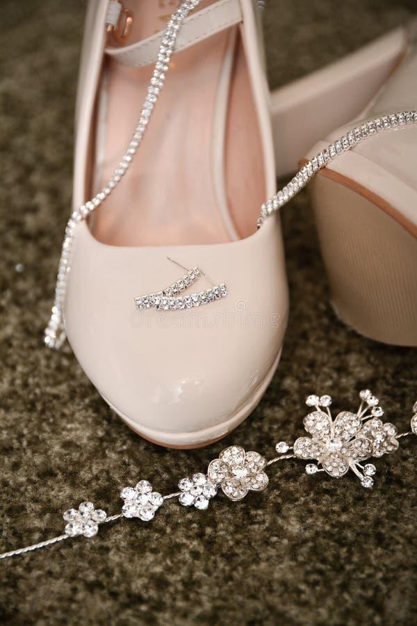 Wedding theme, elegant stylish wedding Shoes and rings royalty free stock photo