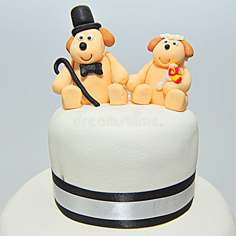 Wedding theme fondant cake figurines - doggies bride and groom. Fondant cake for a wedding stock image