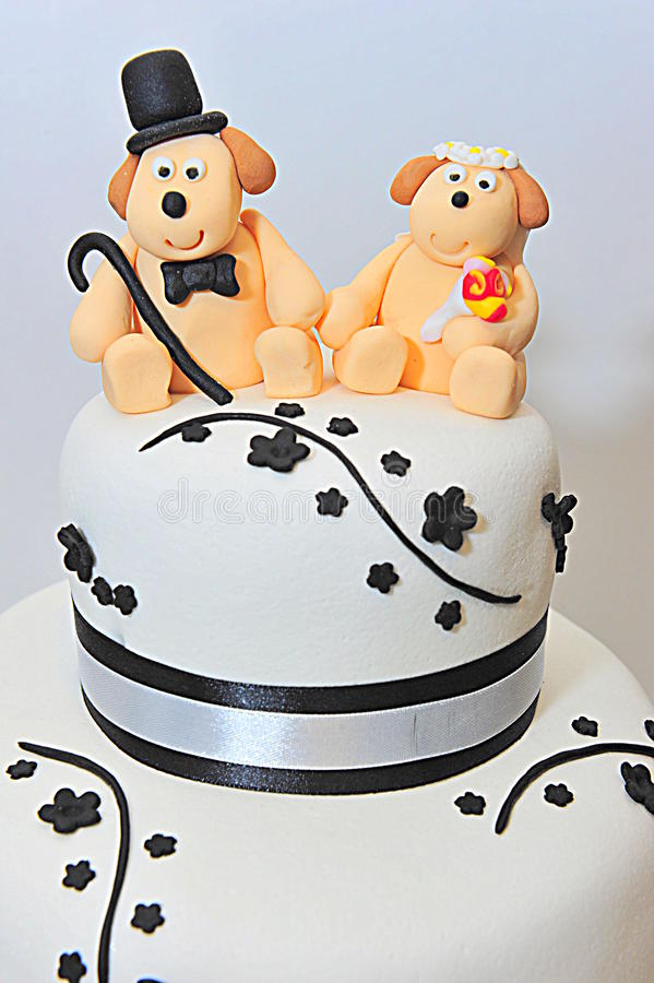 Wedding theme fondant cake figurines - doggies bride and groom. Fondant cake for a wedding stock photo