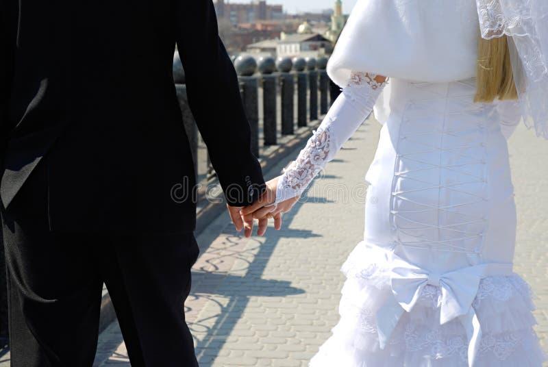 Wedding theme, holding hands newlyweds. stock image