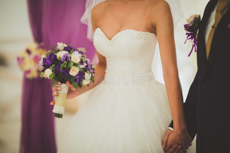 Wedding theme, holding hands newlyweds stock photo