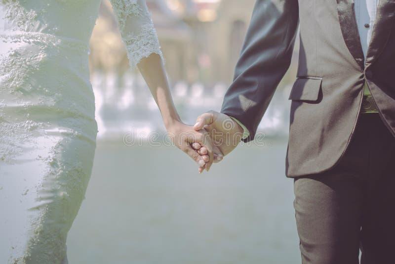 Wedding theme, holding hands newlyweds royalty free stock photo