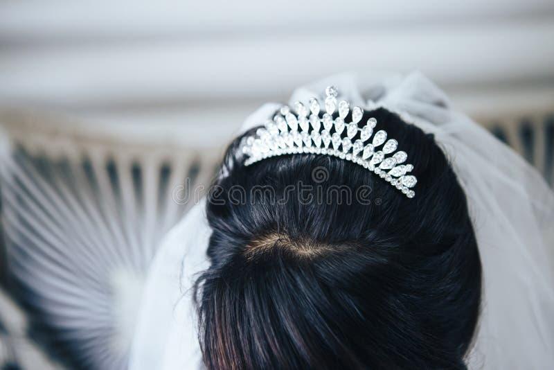 Wedding tiara diadem on the head of the bride. Close-up stock photos