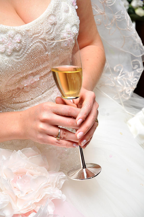 Wedding Toast. Bride holding champagne glass before an wedding reception stock photos
