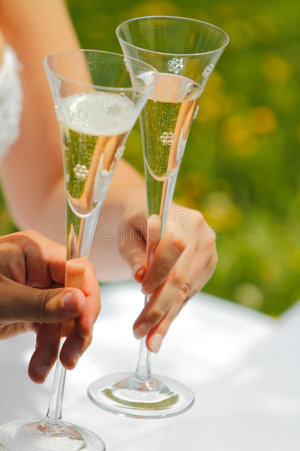 Wedding toast. Woman and man wedding hands with glasses royalty free stock photos
