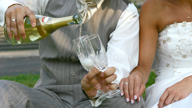 Wedding toast. Womans and mans wedding hands with glasses stock photo