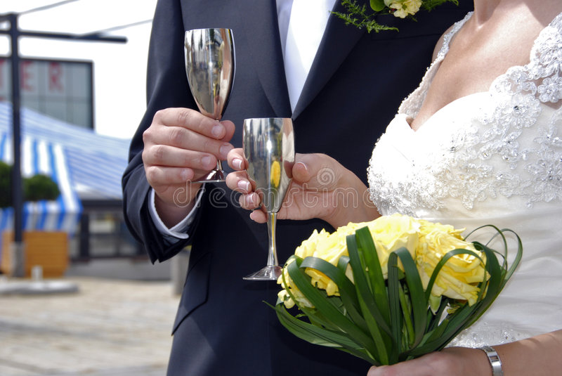 Wedding toast. Womans and mans wedding hands with glasses stock images