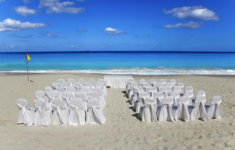 Wedding on tropical beach. Chairs and tables in stock image