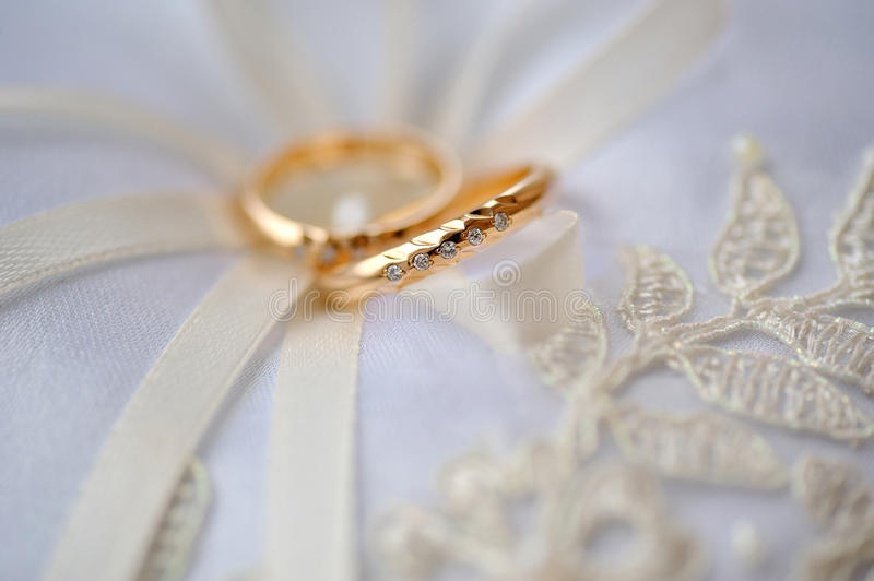 Wedding two gold rings bride and groom stock photo