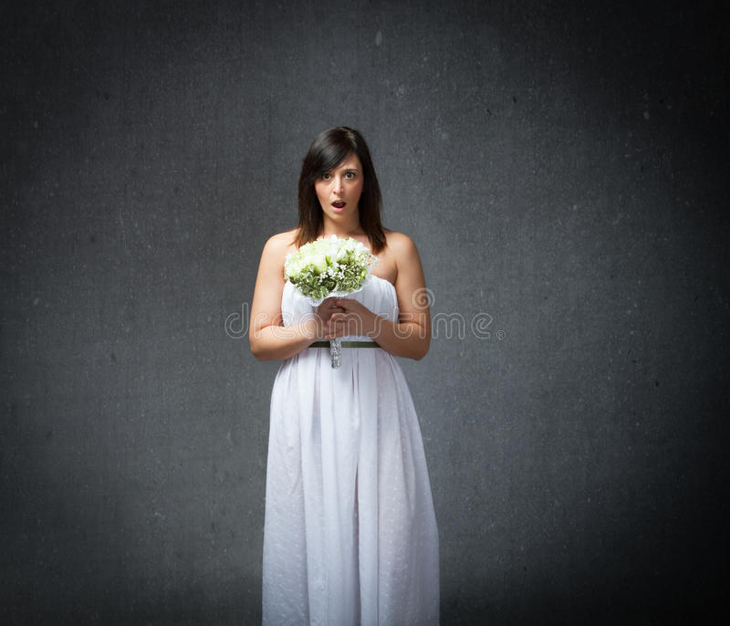 Wedding unbelieving face. People emotions and expressions in dark background royalty free stock photography