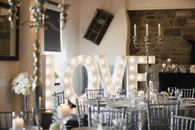 Modern Wedding Venue. Wedding venue is beautifully dressed ready for a dinner party royalty free stock photo